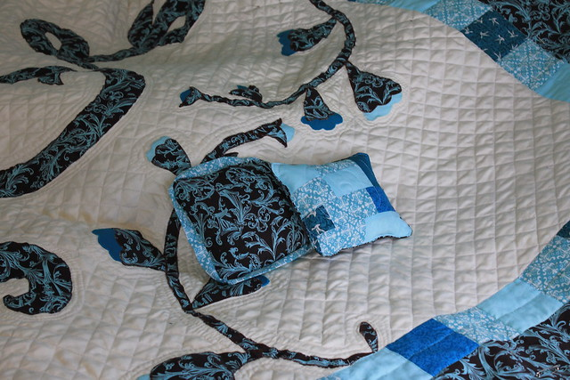 Ring bearer pillows match the wedding quilt.