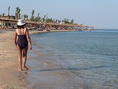 Beach Walking in Sharm El Sheikh (Tasmin_Bahia) Tags: blue trees sea summer sky people holiday tree beach water walking sand scenery pretty waves egypt sharmelsheikh warmth peaceful sunny ripples colourful simple sunbeds