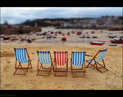 Red White And Blue (peterphotographic) Tags: uk blue red summer england white holiday beach coast miniature cornwall deckchair dof britain depthoffield seashore stives striped summerholiday miniatureeffect canong12