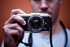 (Paperfist) Tags: portrait self 50mm mirror olympus om f18 ep1 fzuiko