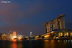 That little sparkles. (Reggie Wan) Tags: city tourism architecture evening singapore asia southeastasia cityscape fireworks ndp bluehour modernbuilding marinabay marinacentre nationaldayparade 2011 moderncity asiancity marinabaysands sonya700 sonyalpha700 marinabaysingapore reggiewan gettyimagessingaporeq1