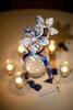 Paper sheet music flower centerpieces (Nightdust) Tags: flowers blue wedding music rose oregon silver paper portland petals bow tables button sheet portlandoregon centerpiece rosepetals vases paperflowers paperflowercenterpiece papersheetmusicflowers