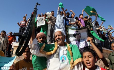 Libyans rally in defense of their revolution led by Muammar Gaddafi. The US/NATO forces have been bombing the North African state for nearly four months. by Pan-African News Wire File Photos