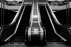 ways (Daniel Kulinski) Tags: city urban blackandwhite bw white abstract black up stairs train underground subway town image metro 10 walk steel escalator transport under shapes evil fast samsung poland ground down sharp ten warsaw civic nx urbanshapes samsungima