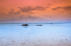Surin Beach (Jim Boud) Tags: ocean longexposure travel blue vacation orange seascape beach water clouds landscape thailand island rocks asia southeastasia paradise tour horizon smooth relaxing vivid wideangle filter thai phuket tobacco efs silky surin sandybeach lightroom artisticphotography superwideangle cokin asiapacific surinbeach phuketisland jimboud canoneos60d jamesboud canonefs1585mmf3556isusm canon1585mm
