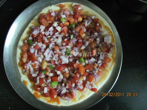 Pizza base with chopped vegetables