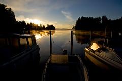 Boats at Sunrise (Petri Karvonen) Tags: sun lake reflection water back