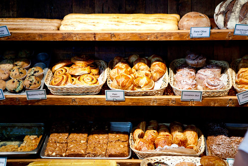 Shelf of freshly baked breads and pastries