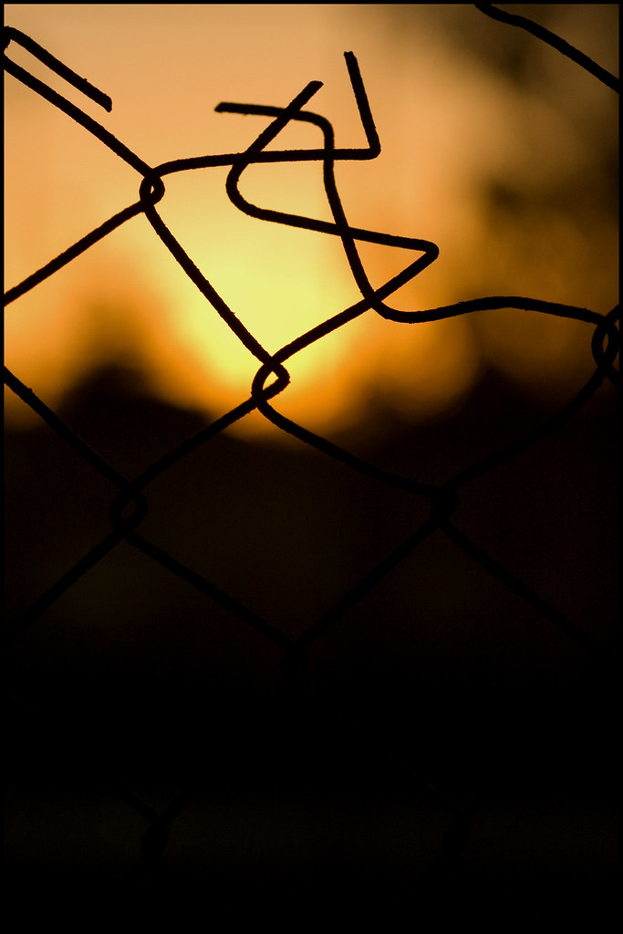 Broken fence at sunset