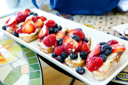 Grilled bread with mascarpone cheese and berries, drizzled with honey