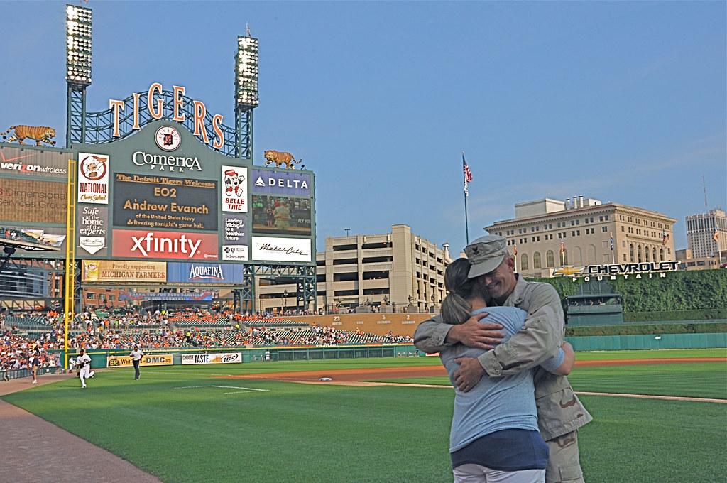 Equipment Operator 2nd Class Andrew Evanch hugs his girlfriend.