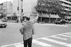 Hailing a Cab II (yonas1) Tags: bw man film 35mm washingtondc dc chinatown iso400 cab taxi voigtlander streetphotography rangefinder dcist intersection ilford bessar2 hailing hailingacab hp5400 wahluckhouse summer2011 6hnw