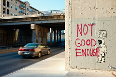 Not Good Enough (Viajante) Tags: street streetart pasteup art car wall austin underpass graffiti us texas message unitedstates protest astronaut
