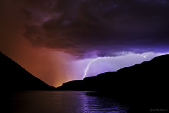 Storm on the River (Dylan MacMaster) Tags: blue red summer reflection story lightning lightpollution boiseriver