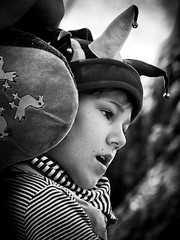 A little jester (Boy With The Coin) Tags: boy portrait blackandwhite bw monochrome face canon eos eyes sad jester structure toned lowkey jingles handicapped 400d silverefexpro