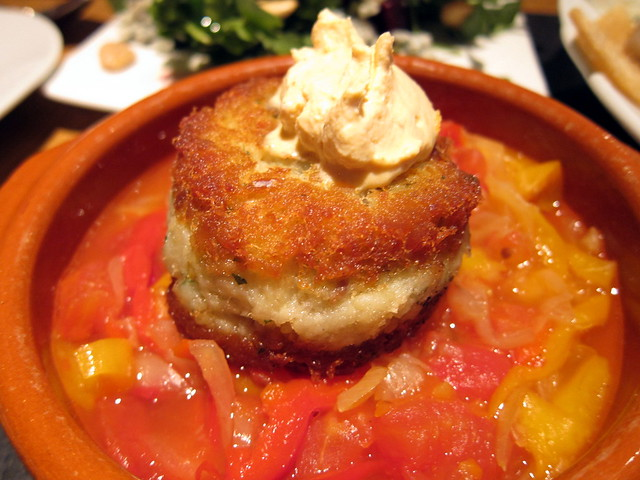 SALT COD CAKE WITH PIPERADE AND CHIPOTLE CREMA