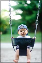 traditions (adr!@n) Tags: park luca swings baseballcap faved nikond3 nikonafnikkor85mmf18d