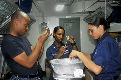 Sailors inspect needles containing influenza v...