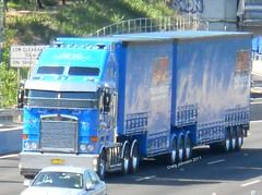 photo by secret squirrel (secret squirrel6) Tags: blue shadow signs motion beautiful lines moving cabin long melbourne bumper chrome huge trailer grille coe visor loaded kw lanes kenworth scrolls monashfreeway cabover aerodyne bdouble dropdeck triaxle roundheadlights taughtliner bogiedrive squaretanks ajmtransport secretsquirrel6truckphotos