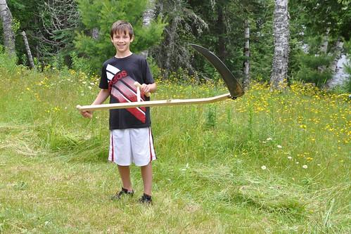 Benton with a scythe