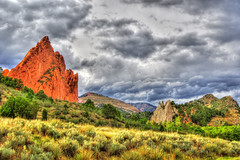 Sunlit Field of Gods - 24x16.250pi - HDR (hgrapek) Tags: red orange nature clouds landscape grey nikon colorado gardenofthegods redrocks hdr photomatix d7000