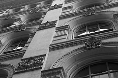 Of Days Gone By (HipChicklette (perenially catching up)) Tags: windows blackandwhite bw reflection building brick philadelphia monochrome up architecture details arches plaster diagonal ornate cornice dentalmolding