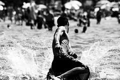 Breaching the Surf (Allan H.) Tags: blackandwhite bw ontario canada beach action streetphotography splash wasagabeach urbanphotography spnp streetphotographynowproject modesofflight allanhamilton themofman