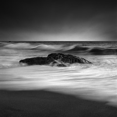 Sonoma Sweep (maxxsmart) Tags: california summer blackandwhite bw seascape film beach water monochrome analog landscape sand rocks waves f16 pacificocean slowshutter sonomacounty marinelayer kodaktmax100 ocea hasselblad500cm 2011 isoasa100 12secondshutter zeiss80mmf28 kodakhc110dilutionh honedeveloped maxxsmart lee9hardedgendgrad