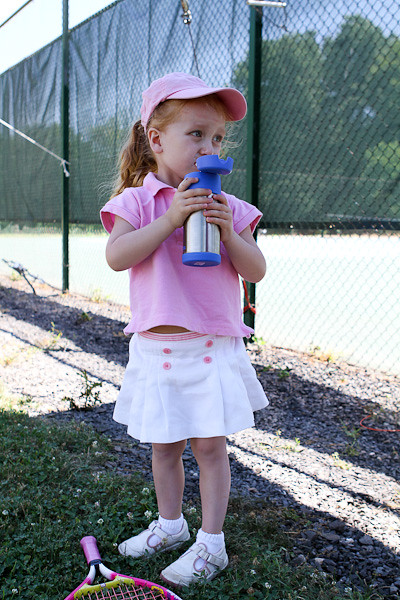 Abigail taking a sip looking on court.jpg