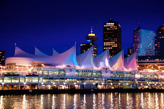 Tonight in Vancouver: Sails in the Twilight ([travelfox]) Tags: city canada vancouver buildings bc dusk britishcolumbia burrardinlet lionsgatebridge canadaplace coalharbour harbourcentre vancouversun pacificclub vancouverlookout theprovince canon50d montecarlocruise prideofvancouver