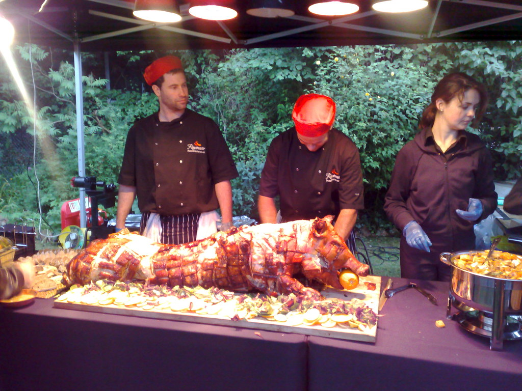 Roastmaster UK chefs carving a spit roasted pig