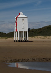 Burnham Lighthouse (Mukumbura) Tags: wood blue light red england sky brown lighthouse white reflection green beach stairs coast wooden sand lighthouses mud legs dunes somerset safety mudflats navigation piles burnhamonsea quicksand lighthouseonlegs summertimeuk