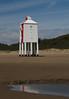 Burnham Lighthouse (Mukumbura) Tags: wood blue light red england sky brown lighthouse white reflection green beach stairs coast wooden sand lighthouses mud legs dunes somerset safety mudflats navigation piles burnhamonsea quicksand lighthouseonlegs summertimeuk