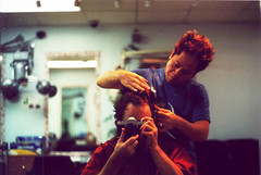 (toby.harvard) Tags: toby usa haircut selfportrait newyork analog photography 50mm mirror still flickr pentax k1000 iso400 harvard grain photojournalism barbershop photograph 35mmfilm barber hairdresser analogue analogphotography reportage celluloid filmphotography 50mmlens analoguephotography tumblr tobyharvard