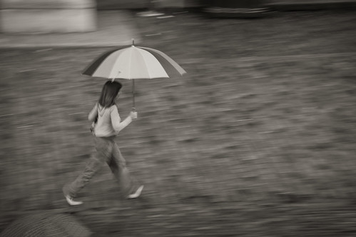 557/1000 - Walking in the rain by Mark Carline