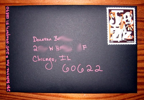 Bright ink on black envelope