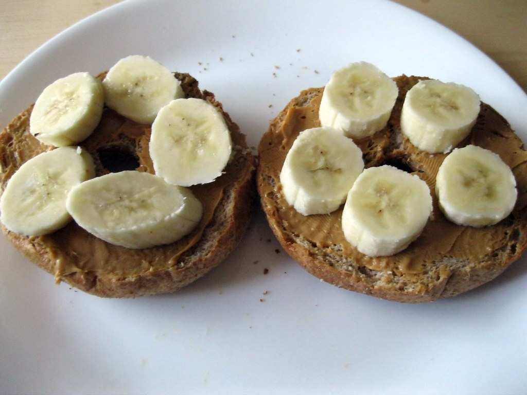 Whole Grain Bagels Topped With Peanut Butter &...