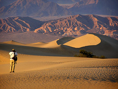 Jim hiking at Mesquite Dunes (MistyDays / CB) Tags: california light sunset copyright usa nature beautiful horizontal america landscape sand desert natura