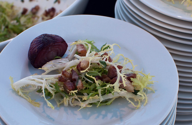 Rustic pork paté with frisée leaves, champagne vinaigrette, poached shallots and crisp filone from Louis Gervais Fine Foods
