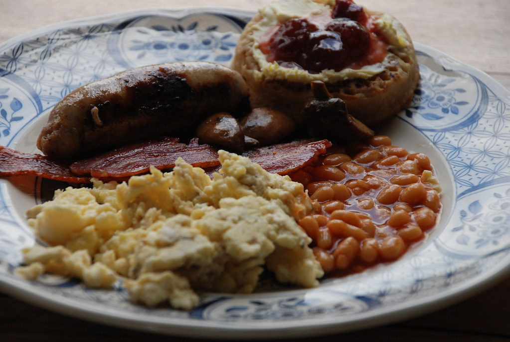 slap-up breakfast (eggs with creme fraiche, Heinz beans, streakey bacon, leek sausage, crumpet with clotted cream and strawberry jam