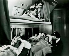 JAPAN AIR LINES -- Mom Get's the Top Bunk all to Herself, While Stewardess Puts the Kids to Sleep Down Below