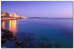 Ortygia - Twilight reflections (ciccioetneo) Tags: longexposure blue sunset sea summer vacation italy holiday seascape speed marina reflections twilight nikon rocks long exposure italia mood slow view angle wide creative violet sigma commons clear cc motionblur filter hour creativecommons shutter syracuse romantic sicily 1020mm grad hitech sicilia siracusa ortigia ortygia passeggio seabed aretusa 09gnd d7000 ciccioetneo