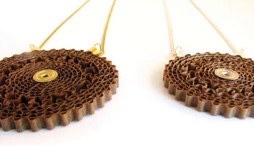 pair of corrugated cardboard necklace pendants