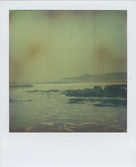 Headland (Lizzie Staley) Tags: ocean blue sea summer seascape green film beach yellow rock polaroid sx70 waves devon foam land instant woolacombe 2011 atz absolutelystunningscapes artistictimezero roidweek2011
