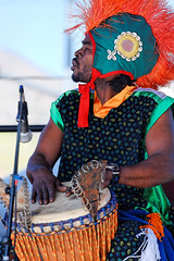 Drummer with the Kotchegna Dance Company at the Montana Folk Festival (CT Young) Tags: dance montana butte african musicfestival buttemontana ivorycoast africandrumming buttemt canonef70200mmf4lusm butteamerica americabutte kotchegnadancecompany montanafolkfestivalbutte montanafolkfestival theminingcity buttemusicfestival ivoriandance mtmontanafolkfestivalperformers montanafolkfestivalbuttefolkfestivalsilverbowcountybutte mtmontanafolkfestivalmusicfestival