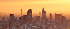 City skyline (cropped to panoramic format) (tomsdigital) Tags: sunset england urban london canon photography country location subject filters canarywharf region thegherkin desc londonskyline canonef70200mmf28lusm canonlens ndgrad canoneos5dmarkii