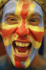 Modern day land Viking   Rob Watkins 2009 (Aland Rob) Tags: west face finland island fan paint emotion painted flag crowd nat games cheers cheer finnish facepaint growl spectator cheering natwest shouting shout aland growling land lander