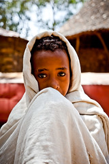 portrait of a child with big intense eyes-monastery lake tana-ethiopia (anthony pappone photography) Tags: africa travel portrait azul barn digital canon pose children photography photo eyes child faces bambini expression retrato african picture culture portraiture childrens afrika enfants fotografia ethiopia orthodox bahirdar ritratto reportage photograher afrique barna phototravel etiopia etnic abyssinia  etnico ethiopie etiope etnia laketana  etnica afryka childrentravel etiopija portraitsofchildren  etiopien etipia  etiopi eos5dmarkii  childrenbestphotos