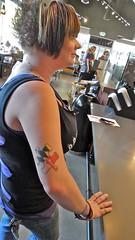 Autism Puzzle Piece Tattoo (Lynn Friedman) Tags: california ca red black tattoo ink logo published symbol marin roadtrip medical puzzle starbucks marincounty sanrafael tat cure autism attribution puzzlepiece 4thst lynnfriedman awaremess