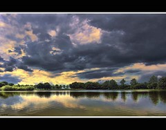 varying weather conditions (Wim Koopman) Tags: trees sky storm holland netherlands dutch rain weather clouds canon reflections photography photo cloudy patterns stock nederland powershot stockphoto s90 stockphotography s100 plassen goudriaan cloudage variability varying wpk s95 slingeland